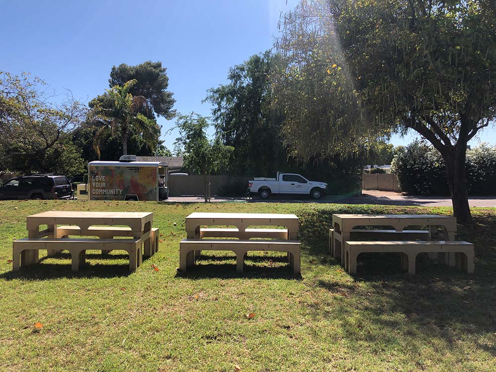 Picnic tables set up outside of MABEL trailer