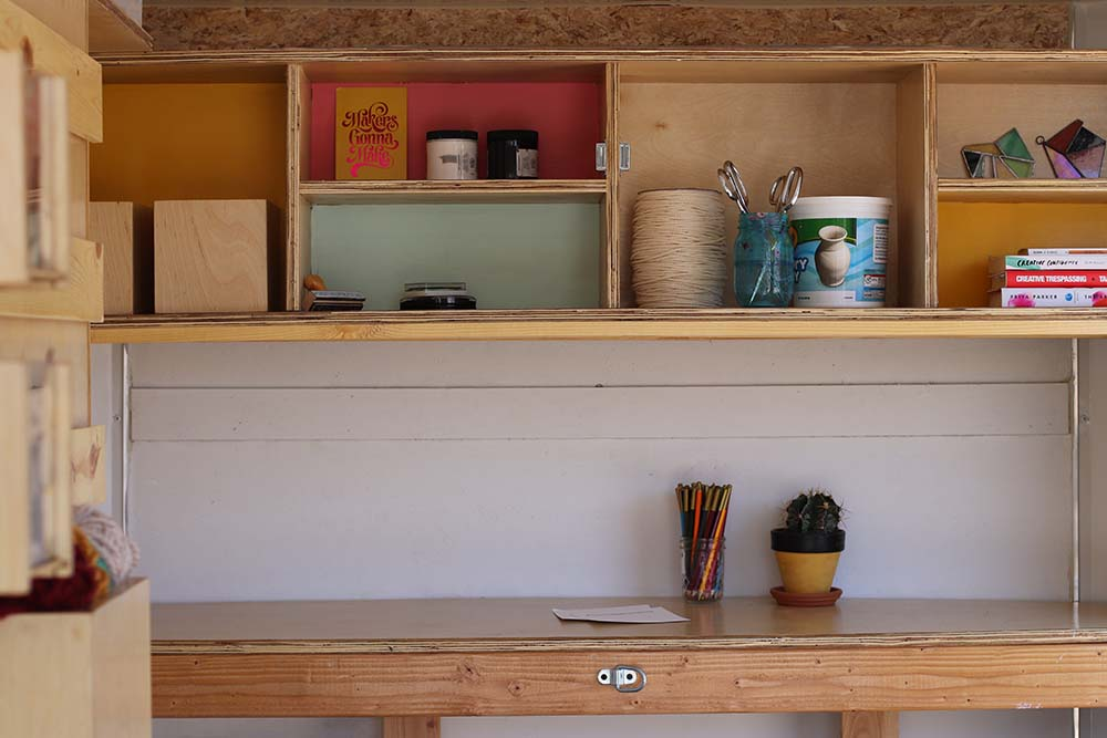 Shelves inside MABEL trailer with art supplies